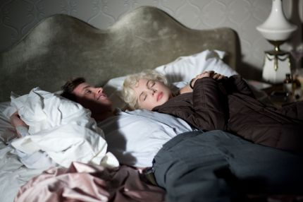 Eddie Redmayne as Colin Clark and Michelle Williams as Marilyn Monroe , My Week With Marilyn (2011)